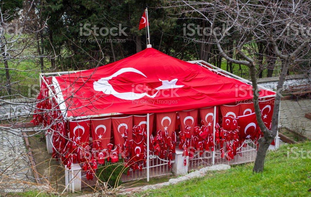 Numerous Turkish flags hanging on grave - Bayrakli Baba stock photo