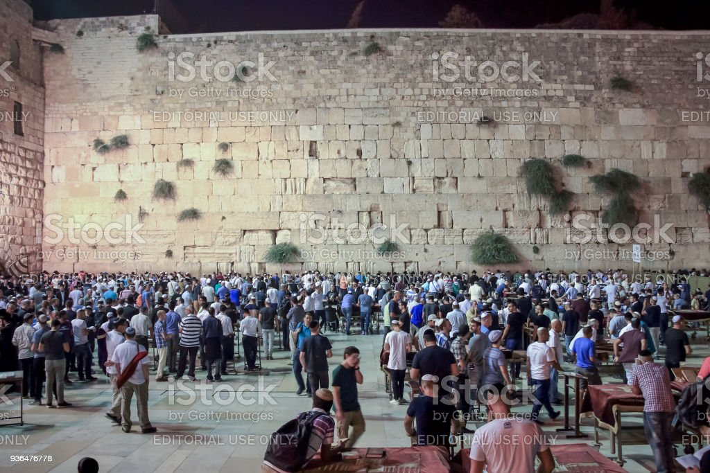 Numerous visitors and believers in the evening near the Western Wall in the old city of Jerusalem, Israel stock photo