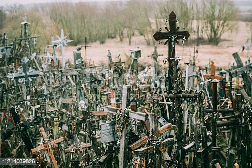 Numerous wooden and metal crucifixes on the hill of crosses in Lithuania. Symbol of faith, hope, and christianity
