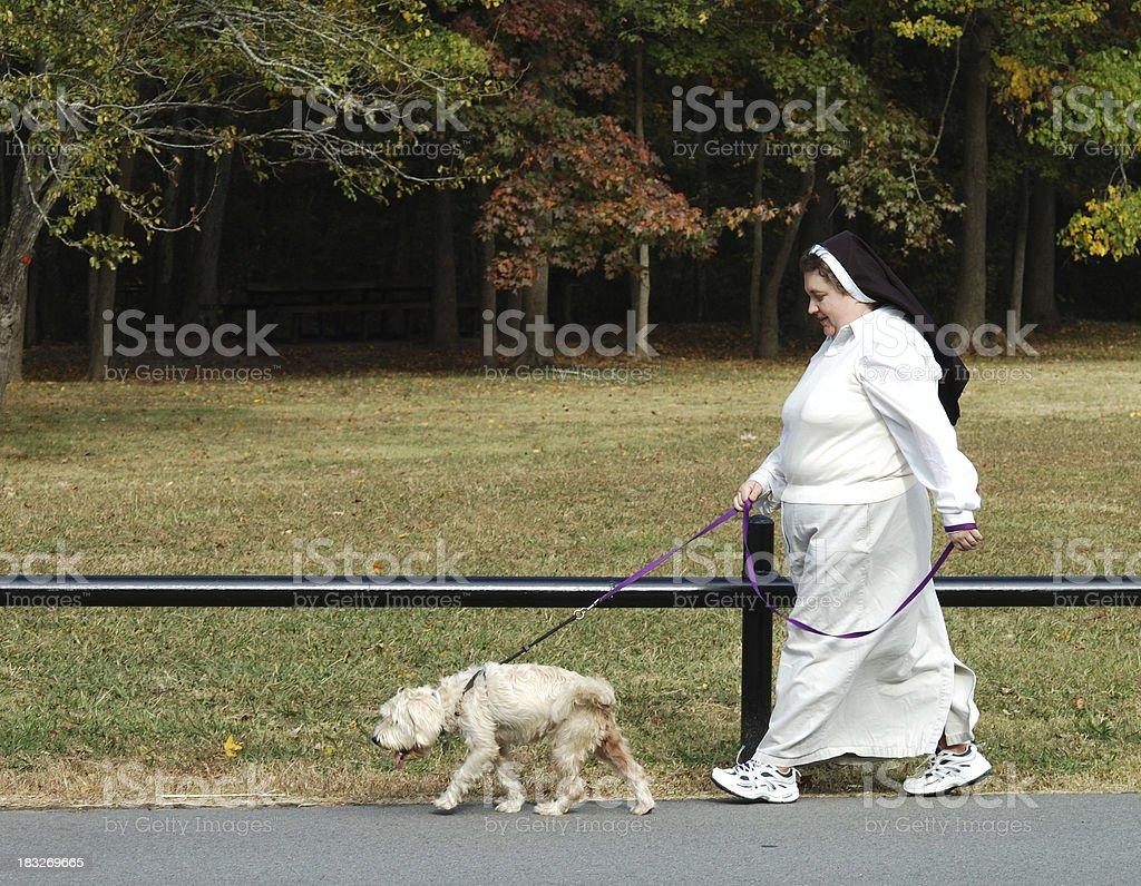 Nun and Her Dog stock photo