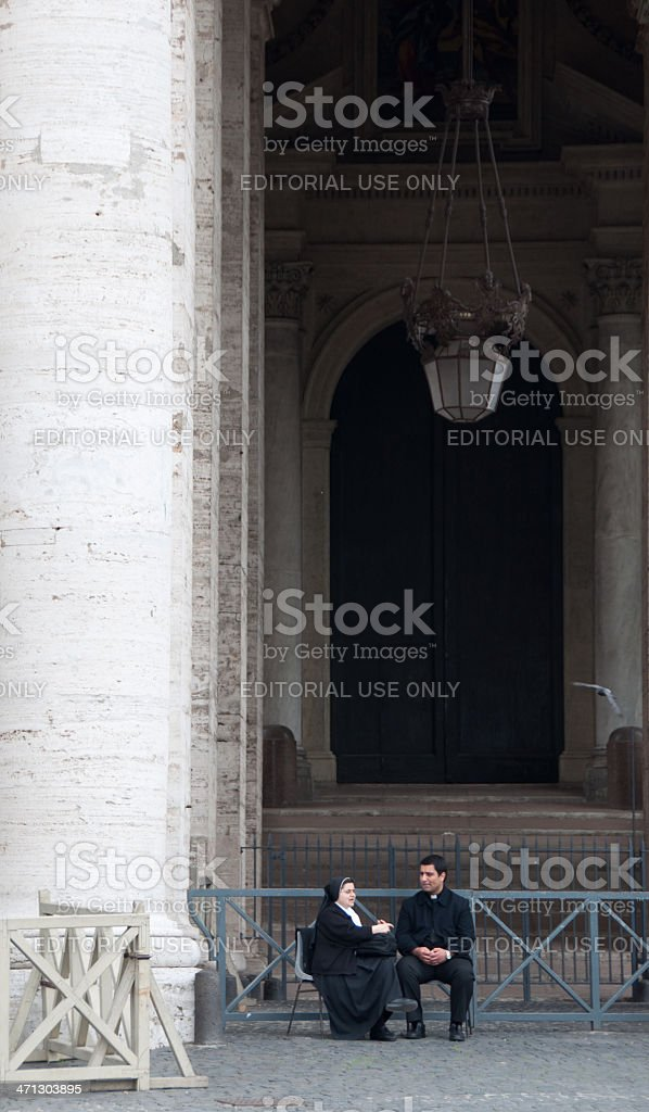 Nun and Priest at St. Peter's Square royalty-free stock photo