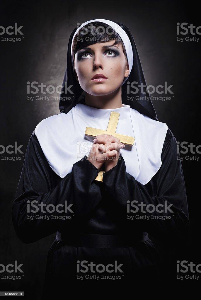 Nun holding a cross royalty-free stock photo