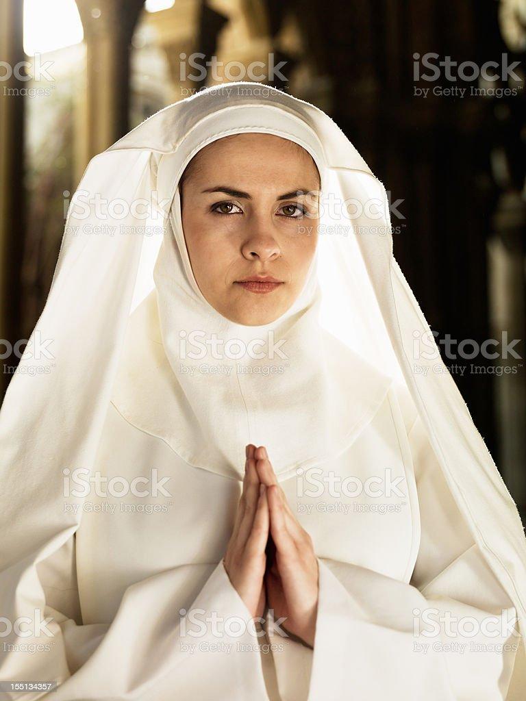 Nun in Prayer stock photo