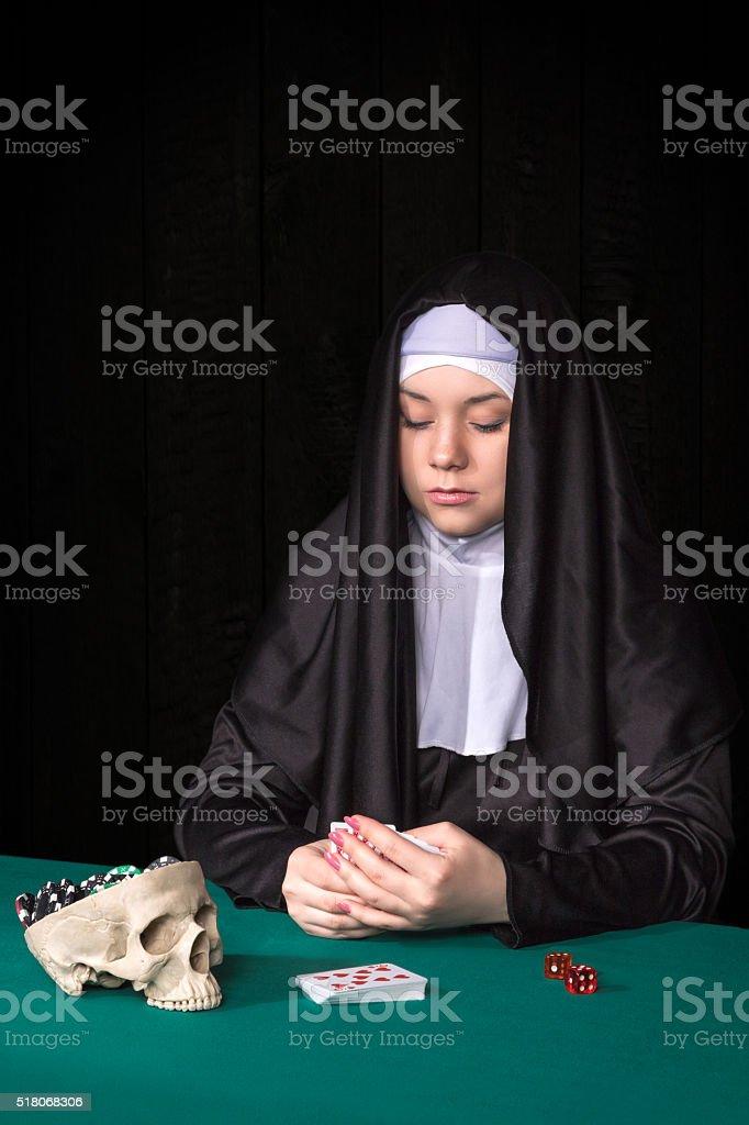 Nun in the gambling concept stock photo
