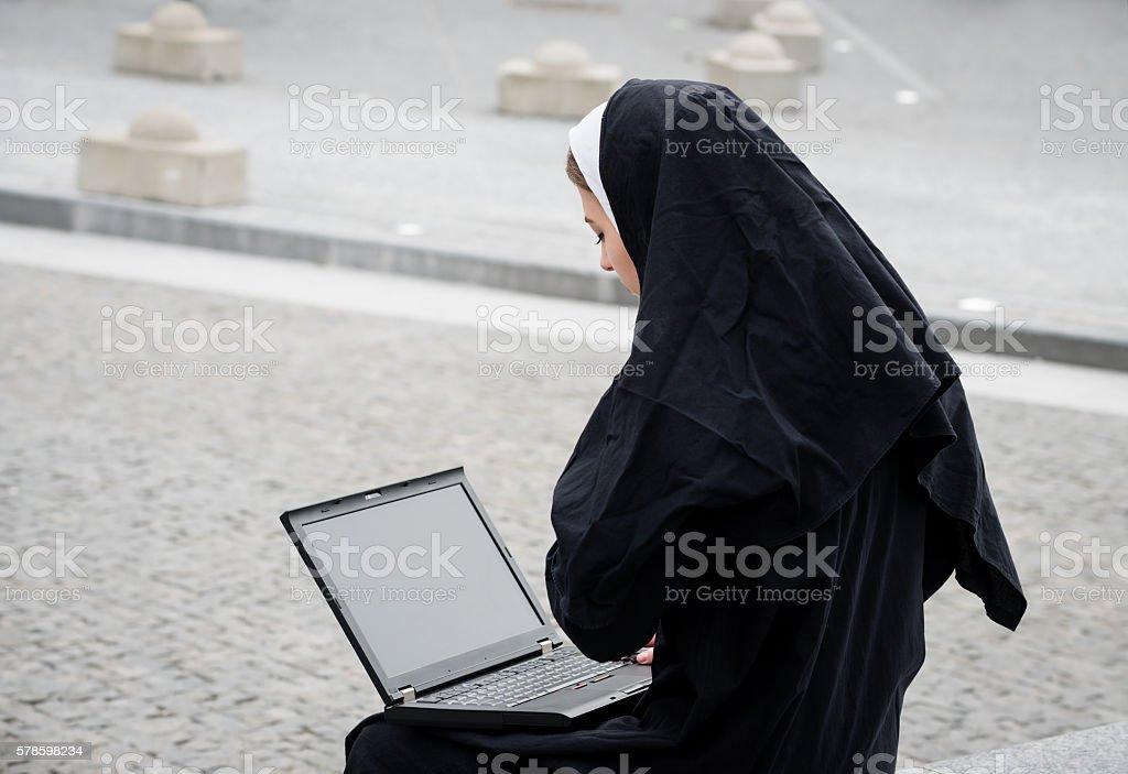 Nun - modern life stock photo