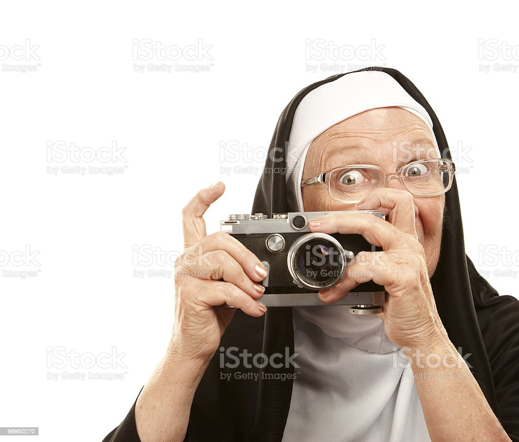 Nun with old camera royalty-free stock photo