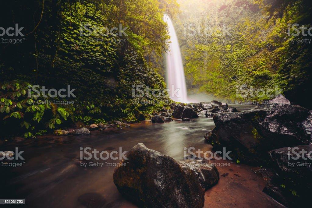Nungnung Waterfall Splashing in Bali Jungle, Indonesia stock photo