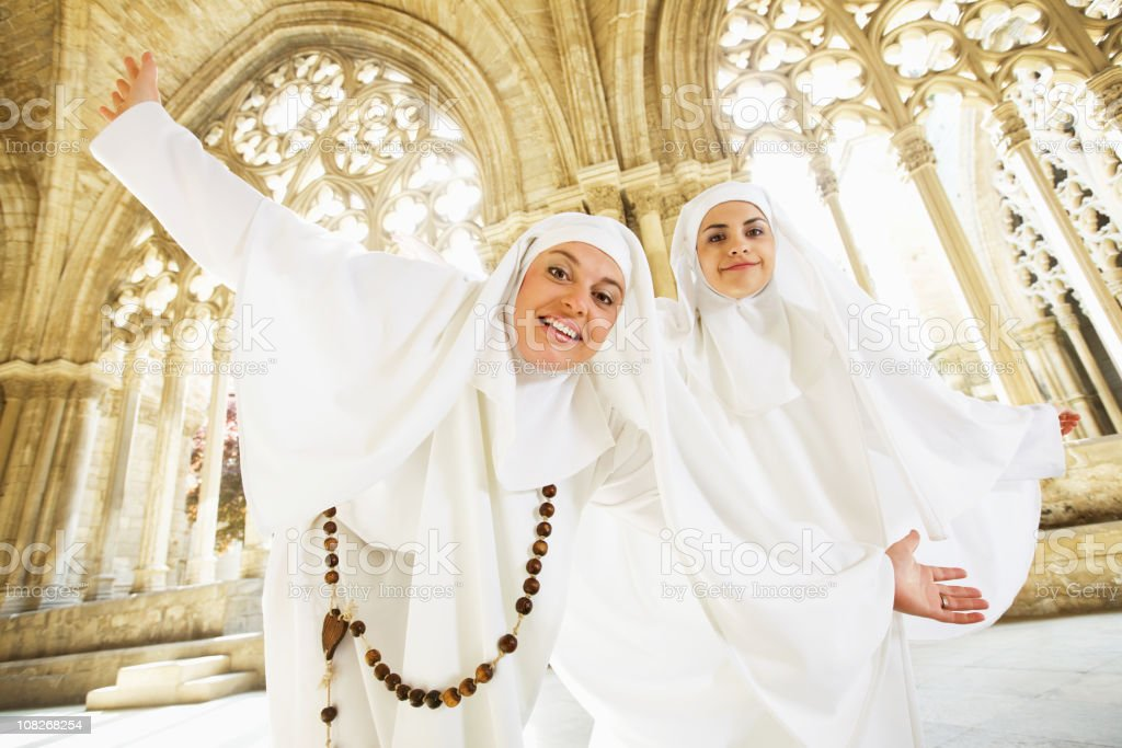 Nuns Dancing in Old Church Cathedral royalty-free stock photo