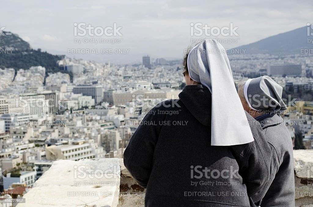 Nuns looking over Athens royalty-free stock photo
