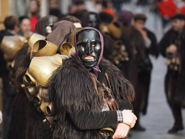 Nuoro, italy. february 18, 2017. Carnival mask parade in Nuoro Italy with Mamuthones looking at crowd around stock photo