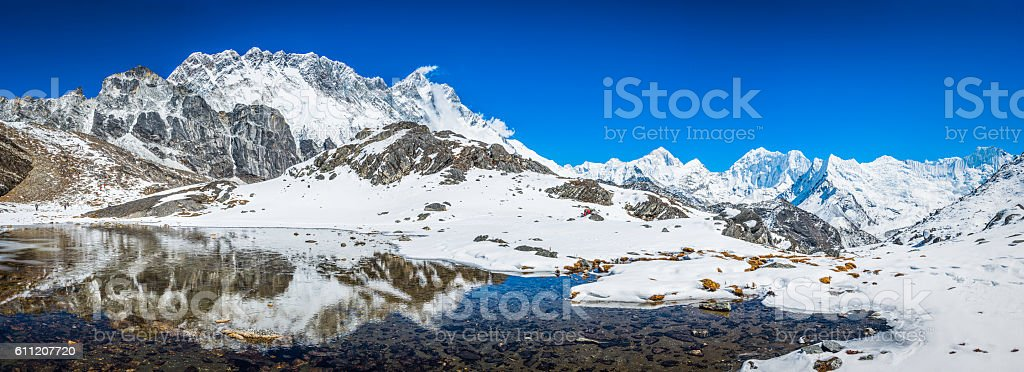 Nuptse Lhotse and Makalu 8485m reflecting Himalayan mountain lake Nepal stock photo