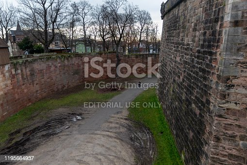 Nuremberg, Germany - dec 20th 2019: Nuremberg historical castle is very well preserved. Person walking the dog gives comparison to the amazing height of defensive wall.