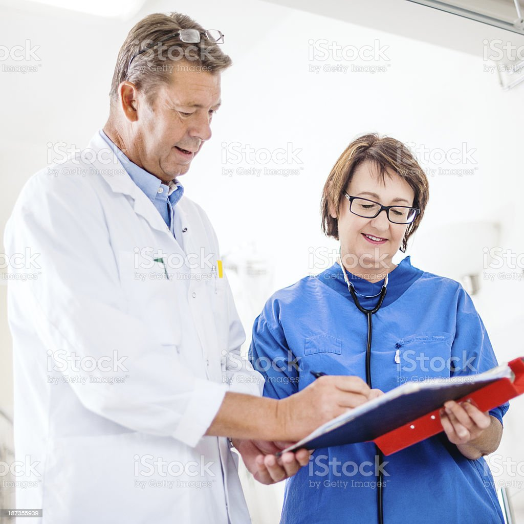 Nurse and doctor doing rounds royalty-free stock photo