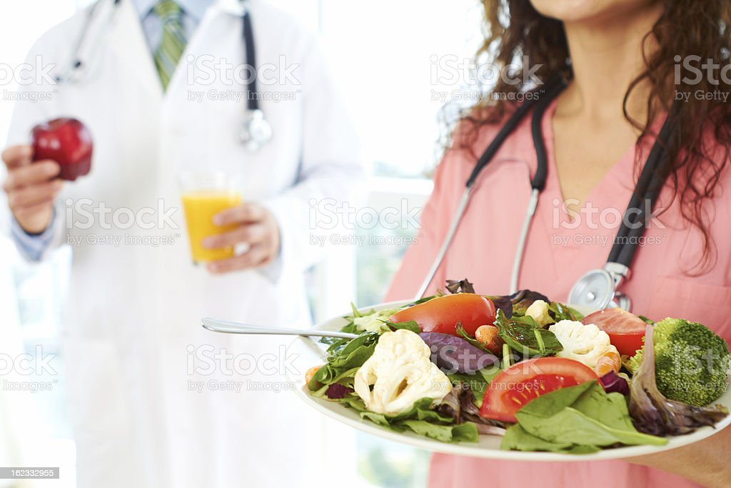 nurse and doctor holding health food royalty-free stock photo