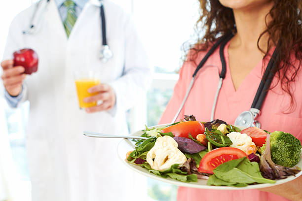 nurse and doctor holding health food stock photo