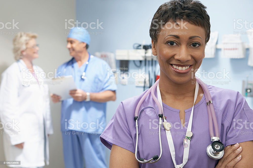 Nurse and doctors in a hospital stock photo
