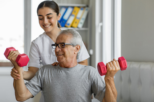 Nurse and male patient exercising