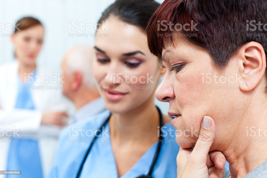 Nurse and patient examining medical records royalty-free stock photo