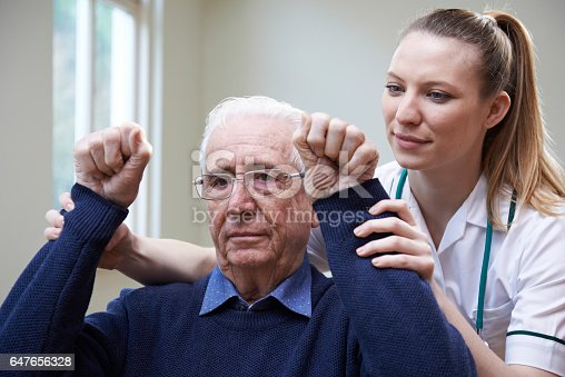 istock Nurse Assessing Stroke Victim By Raising Arms 647656328