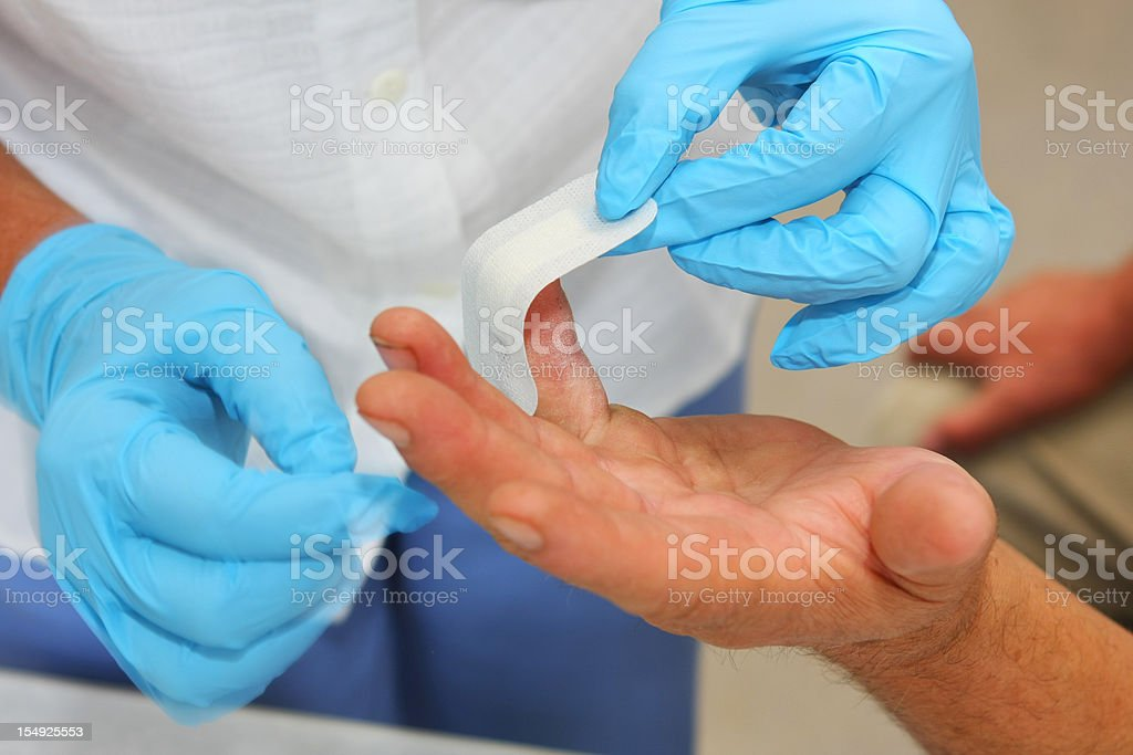 Nurse at work...taking care of wounded patient royalty-free stock photo