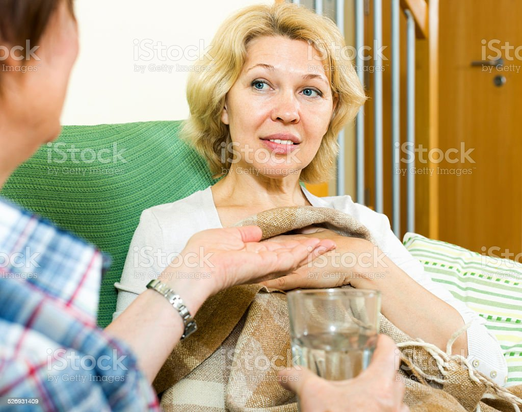nurse caring for a woman stock photo