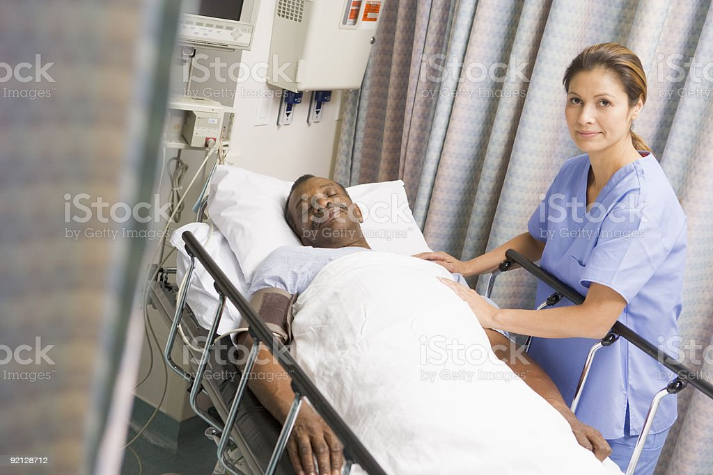 Nurse caring for patient at hospital stock photo