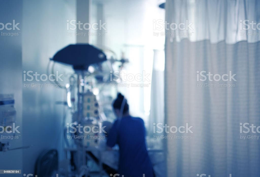 Nurse caring for the patient in the intensive care unit stock photo