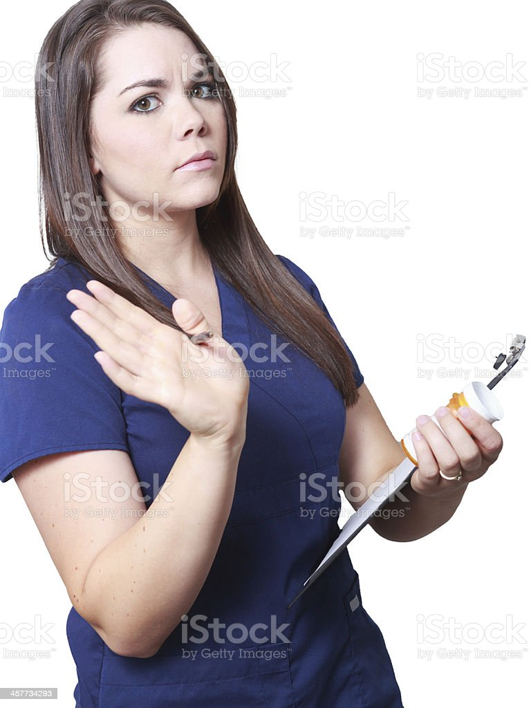 Nurse checking medication and chart sternly stock photo