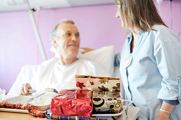 Nurse cheering up patient at Christmas stock photo