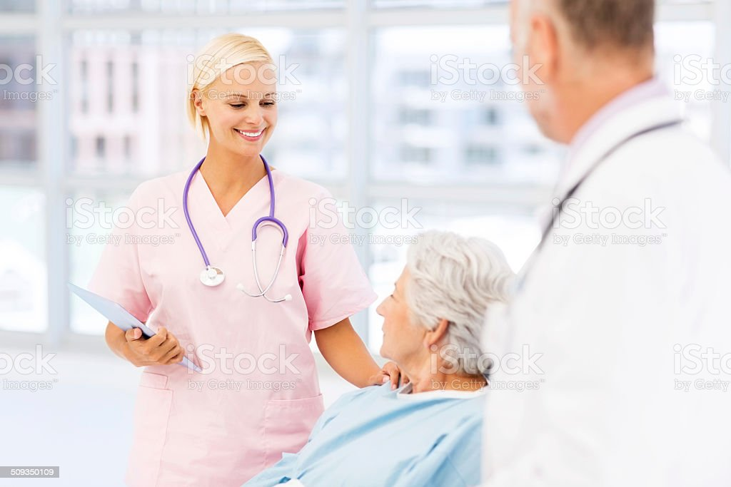 Nurse Comforting Senior Woman In Hospital Ward royalty-free stock photo