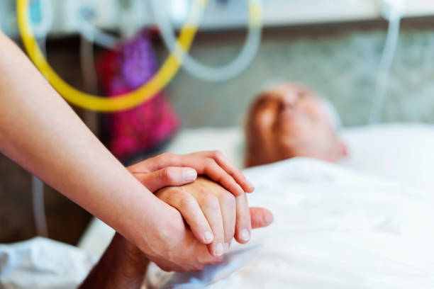 Nurse consoling patient at hospital stock photo