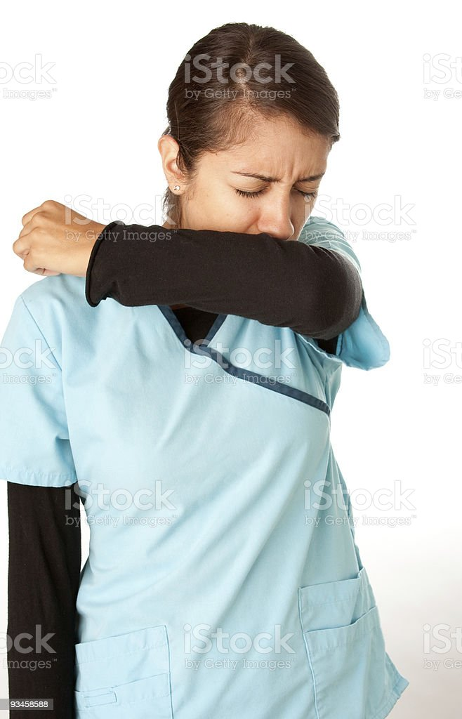 Nurse Coughing into Elbow royalty-free stock photo