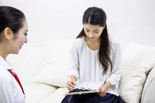Nurse counseling a female patient stock photo