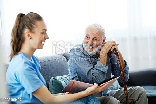 istock nurse doctor senior care brochure showing caregiver help assistence retirement home nursing elderly man 1225199427