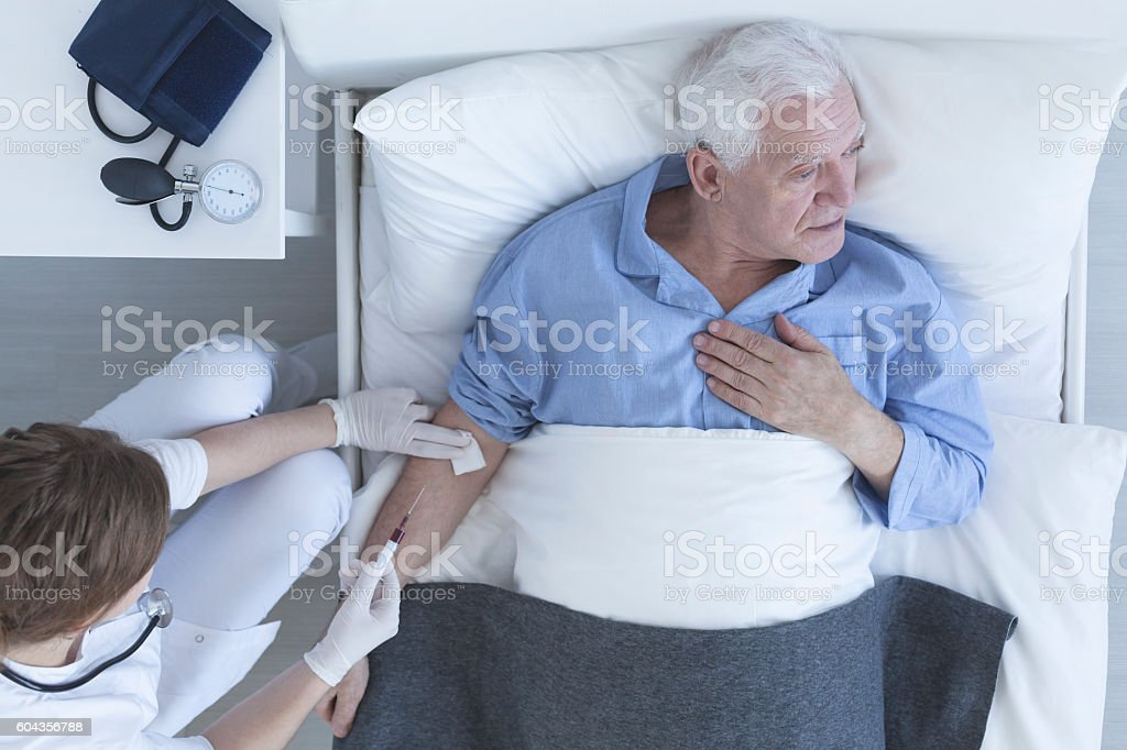 Nurse drawing a blood sample from patient stock photo