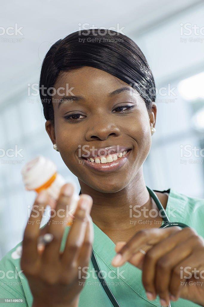 Nurse examines prescription bottle royalty-free stock photo