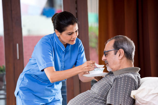 Nurse feeding food to old man on bed picture id1178536705?b=1&k=6&m=1178536705&s=612x612&w=0&h=yx z 7di6m7dd5tzyora8rhtdak tizokreitoekcho=