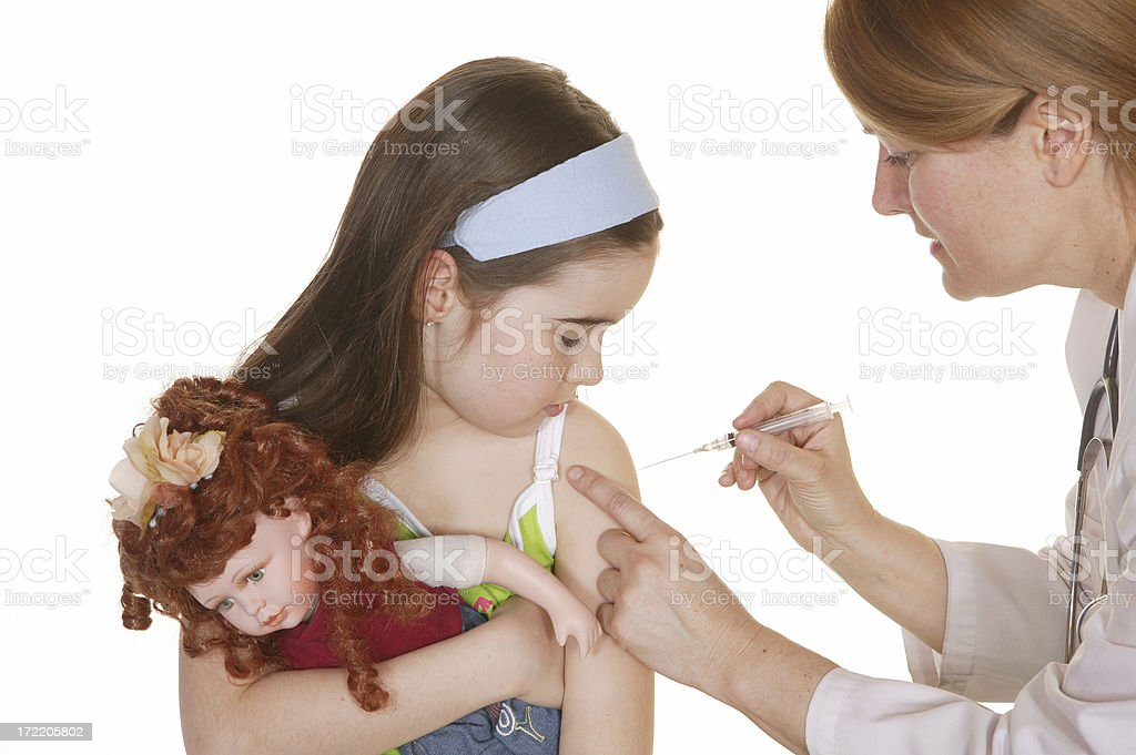 nurse given vaccination to a little girl stock photo