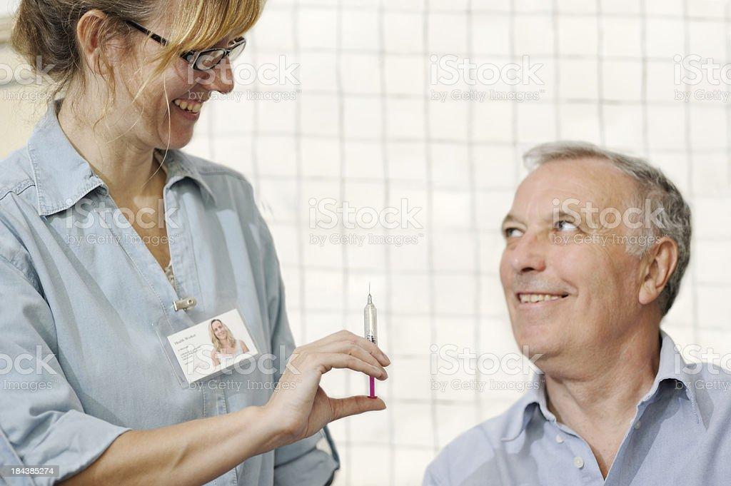 Nurse giving man vaccination royalty-free stock photo