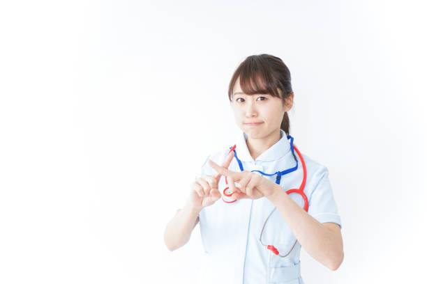 看護師サインを与えることないです。 が - 失敗 ストックフォトと画像