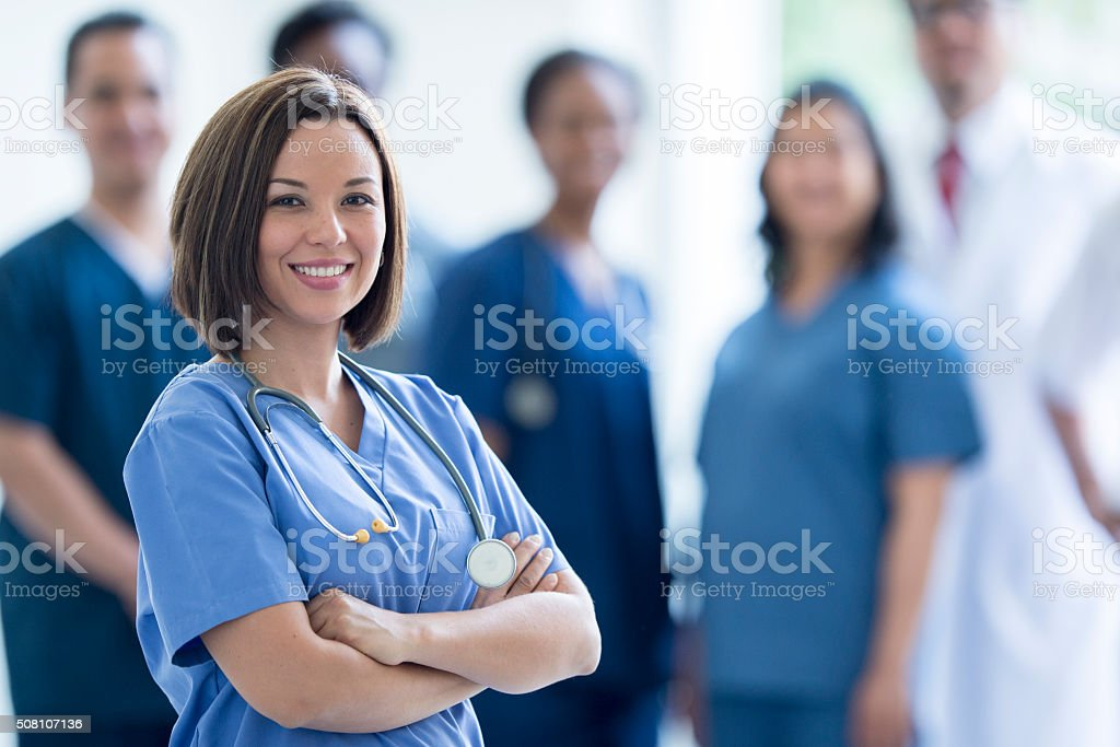 Nurse Happily Standing in a Hospital stock photo