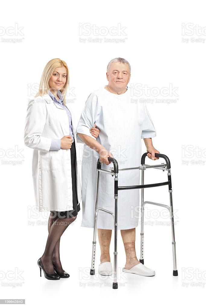 Nurse helping a senior patient to use walker royalty-free stock photo
