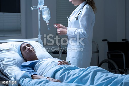 941439642 istock photo Nurse helping dying woman 939771338