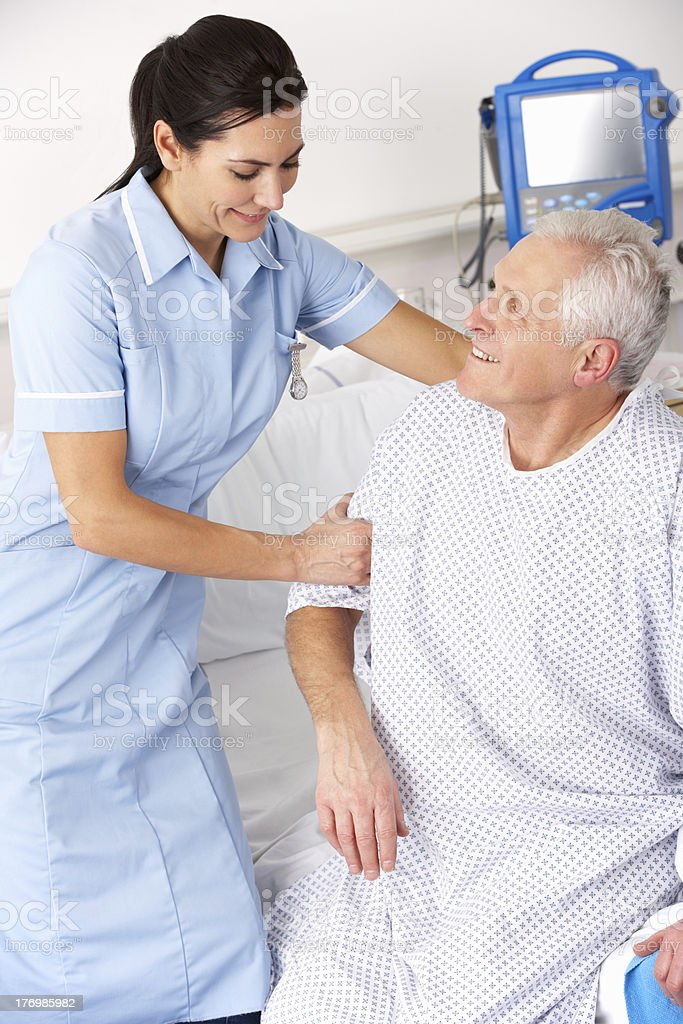 Nurse helping male patient in UK Accident and Emergency royalty-free stock photo
