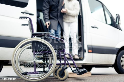 istock nurse helping senior man exit a van 466456685