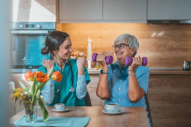 Nurse helping senior woman in lifting dumbbells picture id1133354493?b=1&k=6&m=1133354493&s=612x612&w=0&h=0uv8f8jfq2i0kh9tipl3quicygvxghv5psmyrcgwuwi=