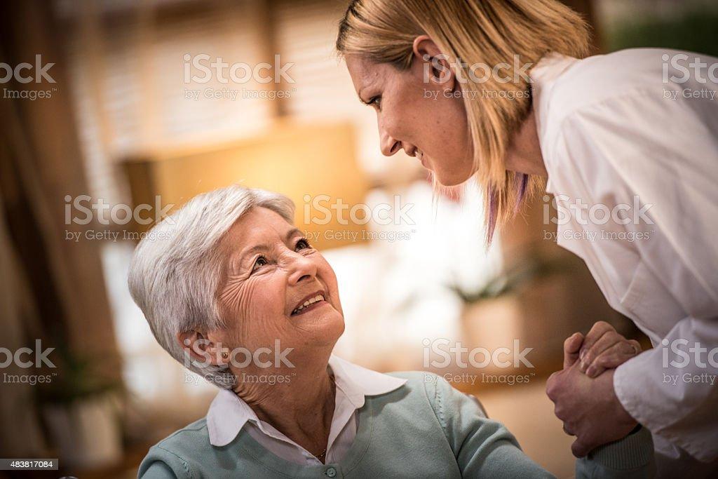 Nurse helping senior woman stock photo