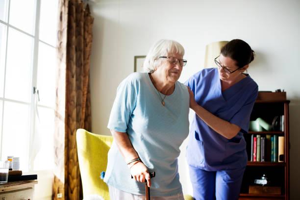 Nurse helping senior woman to stand picture id921617900?b=1&k=6&m=921617900&s=612x612&w=0&h=ke6l43la4wd93rytkujg9hfabtsazjf31jaskktyhsu=