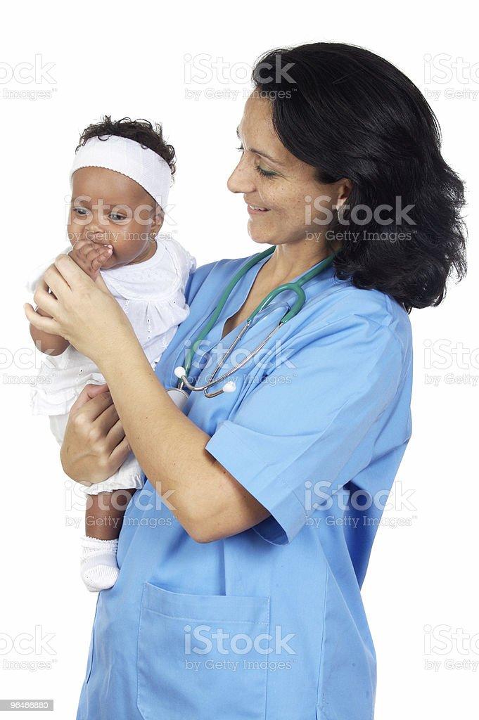 nurse holding baby royalty-free stock photo