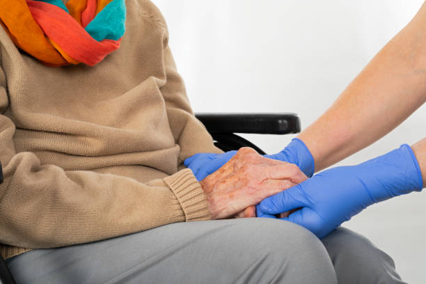Nurse holding disabled womans hands picture id1135329910?b=1&k=6&m=1135329910&s=612x612&w=0&h=rm oniqbs5bod1nz9jk5idu 51a8rbjh qkrloxv 3i=